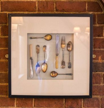 wall mounted vintage knives and forks